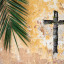 Palm branch and christian cross or crucifix on old vintage traditional wall as palm sunday religion and easter holiday concept background